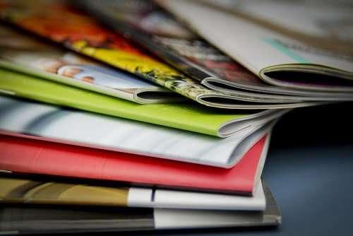 Adobe InDesign - Stack of Print Magazines